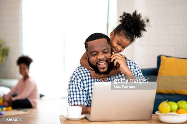 papa please play with me!. a african father working from home, talking on call while cute little daughter disturb her father to stop working. - human body part stock pictures, royalty-free photos & images