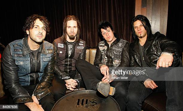 Papa Roach drummer Tony Palermo guitarist Jerry Horton singer Jacoby Shaddix and bassist Tobin Esperance appear at the Wasted Space rock lounge at...