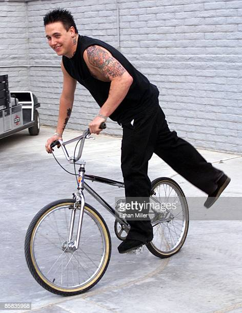 Papa Roach singer Coby Dick rides a bicycle backstage while waiting to perform at KXTE Xtreme Radio's Our Big Concert 4 at Sam Boyd Stadium May 12...