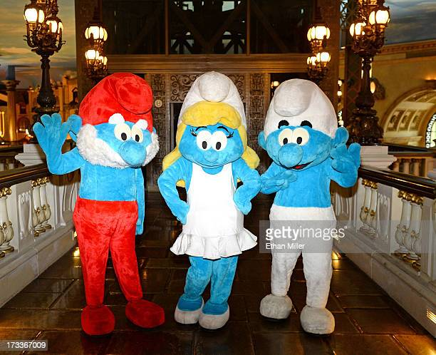 Papa Smurf Smurfette and Clumsy Smurf characters pose during a junket photo call for the Columbia Pictures and Sony Pictures Animation movie 'The...