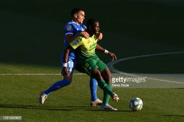 Papakouli Diop of Eibar holds off Mauro Arambarri of Getafe during the La Liga match between Getafe CF and SD Eibar SAD at Coliseum Alfonso Perez on...