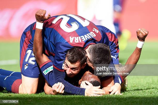 Papakouli Diop of SD Eibar celebrates with his teammates Sergi Enrich and Paulo Oliveira of SD Eibar after scoring his team's second goal during the...