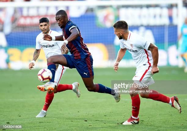 Papakouli Diop of SD Eibar duels for the ball with Ever Banega of Sevilla FC during the La Liga match between SD Eibar and Sevilla FC at Ipurua...
