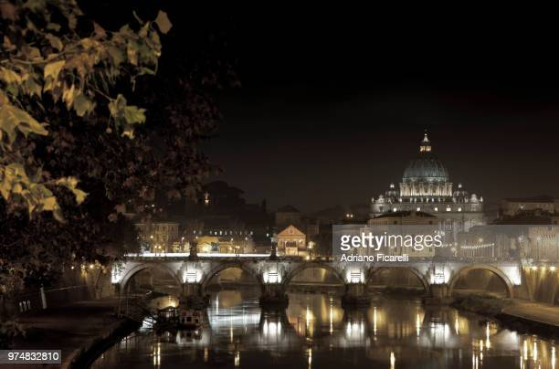 papal basilica of st. peter at night, vatican - adriano ficarelli stock pictures, royalty-free photos & images