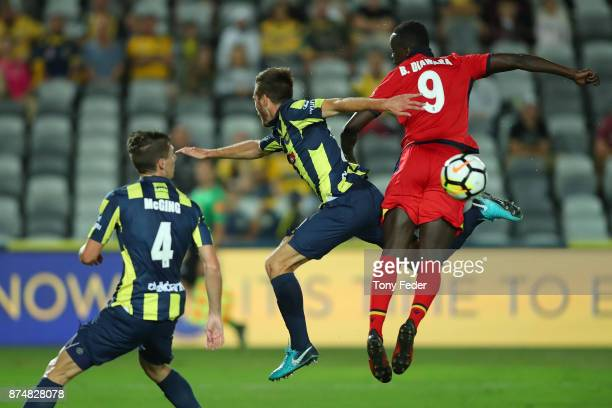 Papar Babacar Diawara of Adelaide United and Liam Rose of the Mariners contest the ball during the round seven A-League match between the Central...