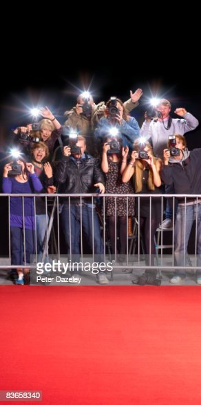 paparazzi behind railings and red carpet stock photo