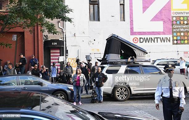 Paparazzi camp outside Kanye West and Kim Kardashian's apartment in New York on October 4 2016 Kim Kardashian freed herself and raised the alarm...