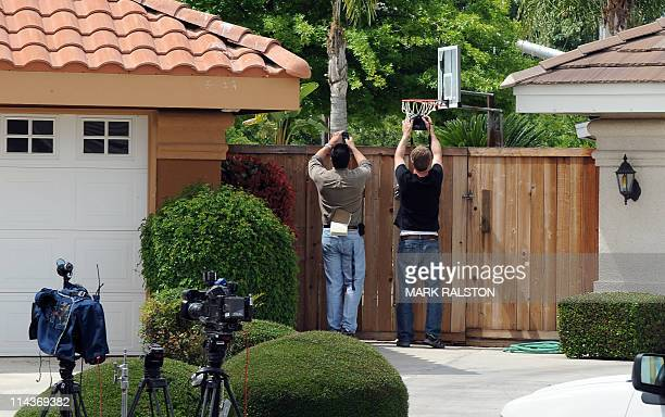Paparazzi look over the fence outside the home of Mildred Patricia Baena, the former maid who mothered a child by actor and former Californian...