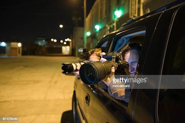 Paparazzi photographer in car