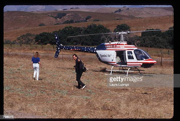 Paparazzi photographer Jim Ryman boards a helicopter to cover Elizabeth Taylor's wedding held at Michael Jackson's Neverland Valley Ranch October 6...