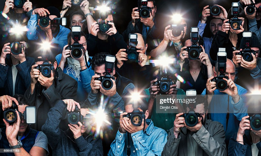 Paparazzi photographers in action : Stock Photo