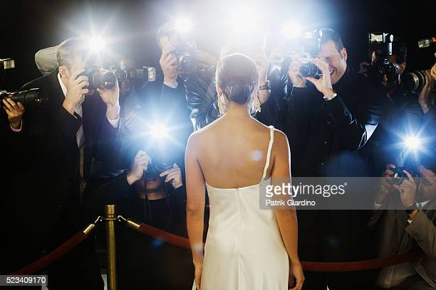paparazzi photographing celebrity at red carpet event - awards ceremony stock pictures, royalty-free photos & images