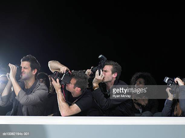 Paparazzi photographing fashion show