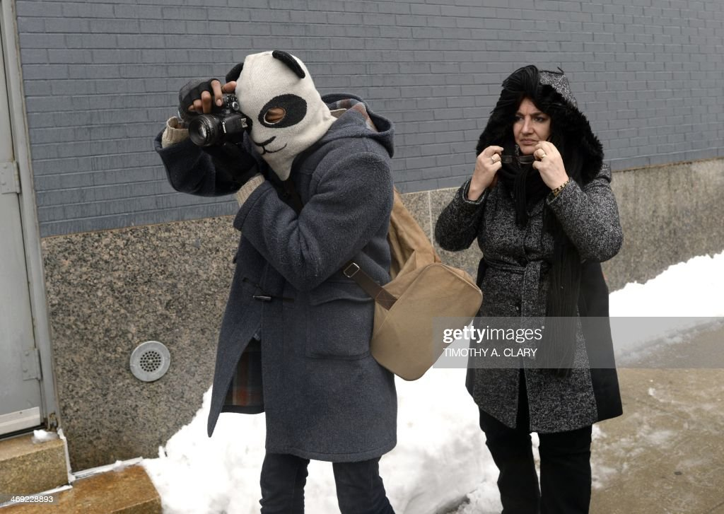 A Paparazzi shoots celebrities after the conclusion of the Calvin Klein show during the Mercedes-Benz Fashion Week Fall/Winter 2014 shows February 13, 2014 in New York City. AFP PHOTO / Timothy CLARY