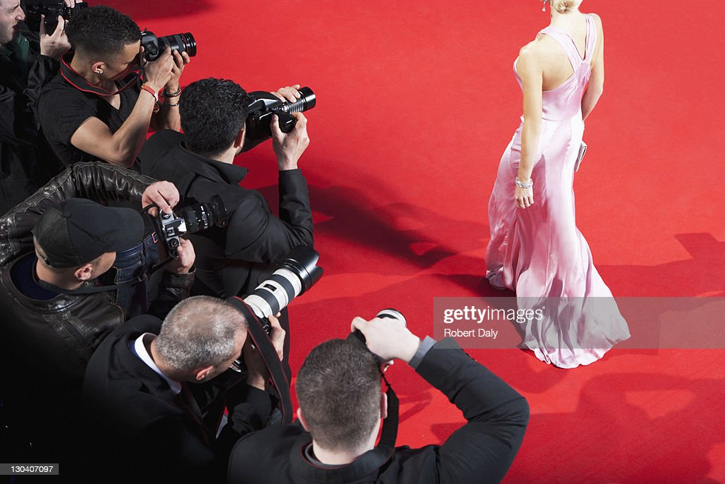 Paparazzi taking pictures of celebrity on red carpet : Stock Photo