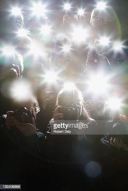 paparazzi taking pictures with flash - celebrities photos stock pictures, royalty-free photos & images
