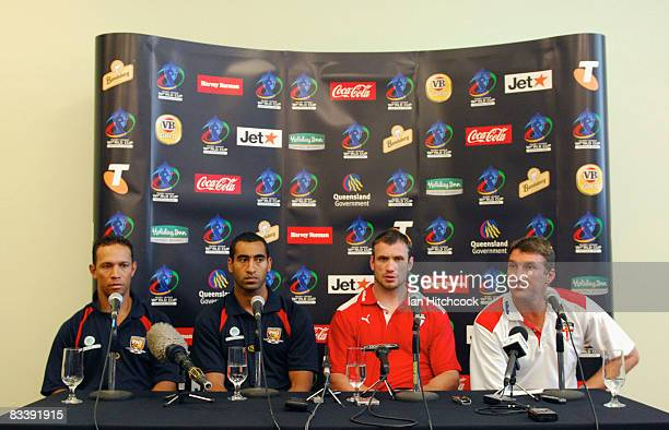 Papaua New Guinea coach Adrian Lam with team captain John Wilshere with England captain Jamie Peacock and coach Tony Smith coach at a press...
