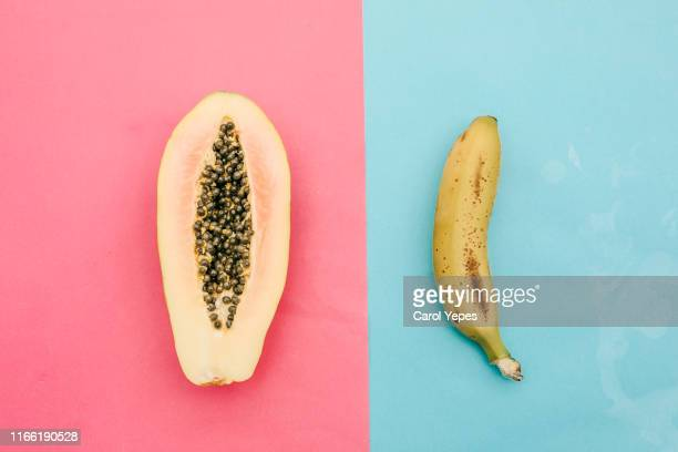 papaya and banana from above. sex concept - human sexual behavior stock pictures, royalty-free photos & images