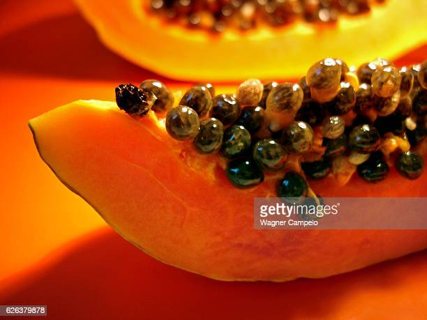 papaya on orange - papaya stock photos and pictures