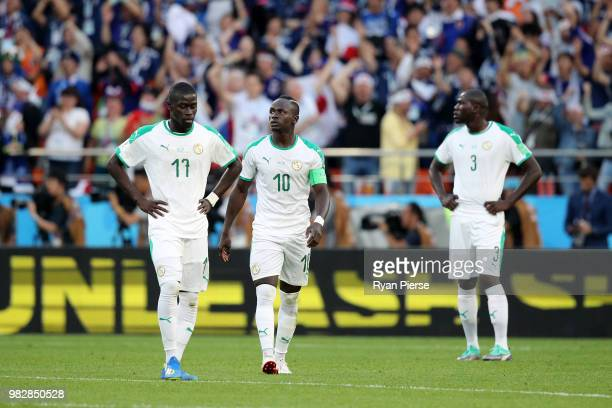 Pape Alioune Ndiaye and Sadio Mane of Senegal look dejected following Japan's first goal during the 2018 FIFA World Cup Russia group H match between...