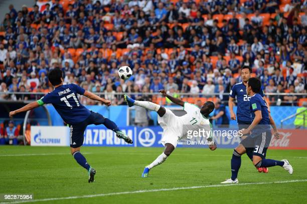 Pape Alioune Ndiaye of Senegal battles for the ball with Makoto Hasebe of Japan during the 2018 FIFA World Cup Russia group H match between Japan and...