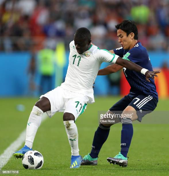 Pape Alioune Ndiaye of Senegal is challenged by Makoto Hasebe of Japan during the 2018 FIFA World Cup Russia group H match between Japan and Senegal...