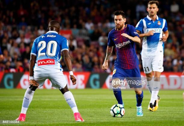 Pape Diop and Leo Messi during La Liga match between FC Barcelona v RCD Espanyol in Barcelona on September 09 2017