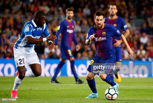 Pape Diop and Leo Messi during La Liga match between FC Barcelona v RCD Espanyol in Barcelona on September 09 2017