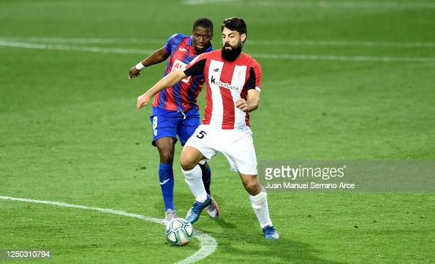 Pape Diop of SD Eibar battles for possession with Asier Villalibre of Athletic Club during the La Liga match between SD Eibar SAD and Athletic Club...