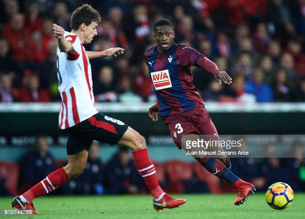 Pape Diop of SD Eibar being followed by Ander Iturraspe of Athletic Club during the La Liga match between Athletic Club and Eibar at Estadio San...