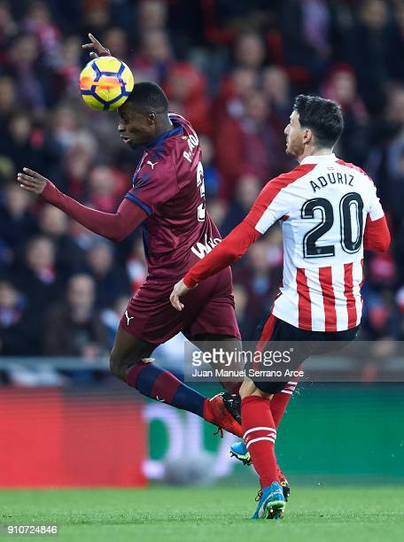 Pape Diop of SD Eibar being followed by Aritz Aduriz of Athletic Club during the La Liga match between Athletic Club and Eibar at Estadio San Mames...