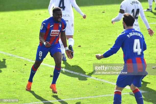 Pape Diop of SD Eibar celebrates with teammate Paulo Oliveira after scoring his team's first goal during the La Liga Santander match between SD Eibar...