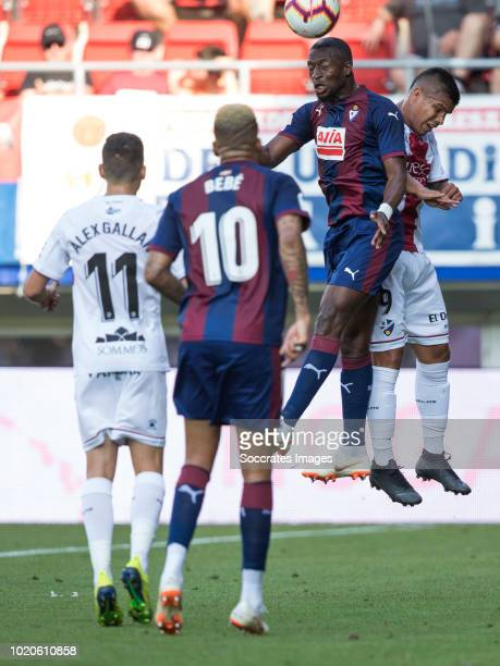 Pape Diop of SD Eibar Cucho Hernandez of SD Huesca during the La Liga Santander match between Eibar v SD Huesca at the Estadio Municipal de Ipurua on...
