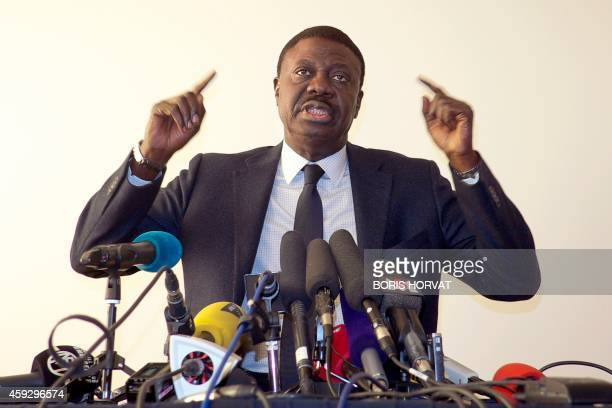 Pape Diouf former president of French L1 football team Olympique de Marseille gestures as he responds to journalists' questions in Marseille on...