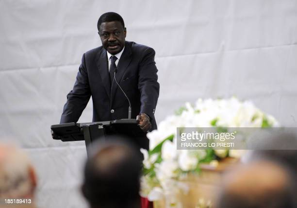 Pape Diouf former President of Olympique de Marseille speaks in front of the coffin of French coach Bruno Metsu during his funeral ceremony on...