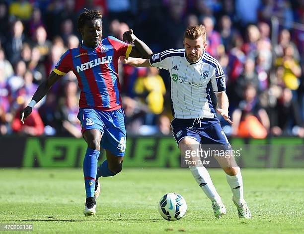 Pape N'Diaye Souare of Crystal Palace and James Morrison of West Brom compete for the ball during the Barclays Premier League match between Crystal...