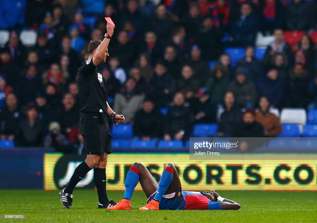 Pape N'Diaye Souare of Crystal Palace is shown a red card by referee Robert Madley during the Barclays Premier League match between Crystal Palace and Watford at Selhurst Park on February 13, 2016 in London, England.