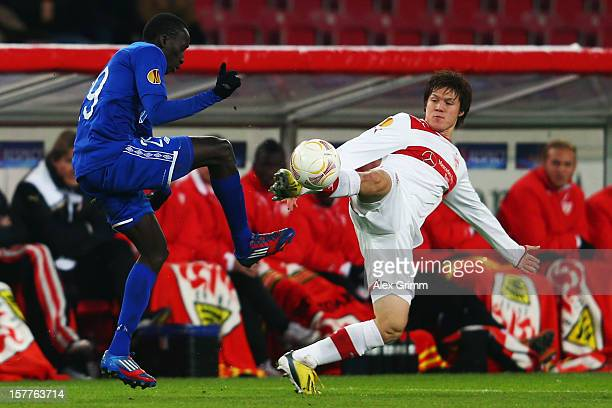 Pape Pate Diouf of Molde is challenged by Gotoku Sakai of Stuttgart during the UEFA Europa League group E match between VfB Stuttgart and Molde FK at...