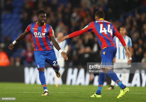 Pape Souare of Crystal Palace celebrates with Jairo Riedewald of Crystal Palace after coming on the pitch during the Carabao Cup Third Round match...