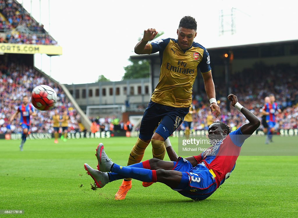 Pape Souare of Crystal Palace challenges Alex Oxlade-Chamberlain of Arsenal during the Barclays Premier League match between Crystal Palace and Arsenal at Selhurst Park on August 16, 2015 in London, England.