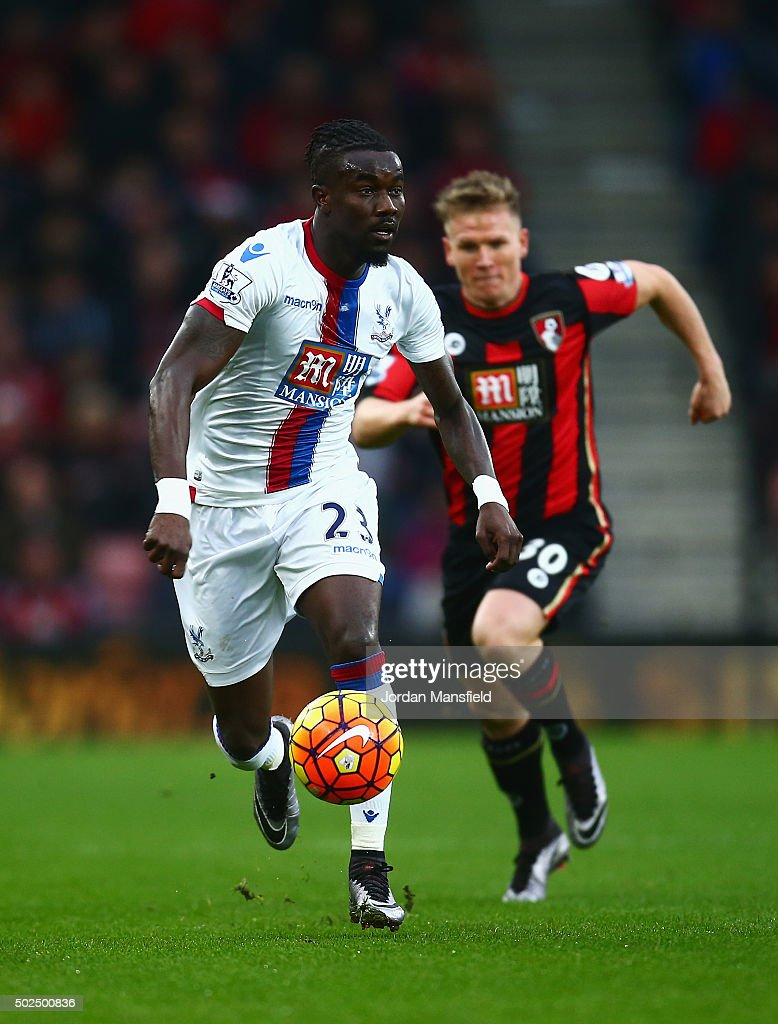 Pape Souare of Crystal Palace goes past Matt Ritchie of Bournemouth during the Barclays Premier League match between A.F.C. Bournemouth and Crystal Palace at Vitality Stadium on December 26, 2015 in Bournemouth, England.