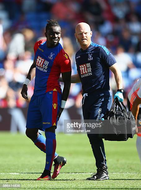 Pape Souare of Crystal Palace leaves the field holding his thigh during the Pre Season Friendly match between Crystal Palace and Valencia at Selhurst...