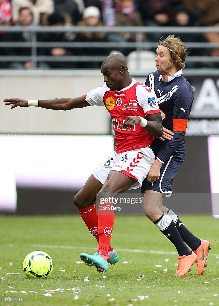 Pape Souare of Reims and Jaroslav Plasil of Bordeaux fight for the ball during the French Ligue 1 match between Stade de Reims and Girondins de Bordeaux at the Stade Auguste Delaune on December 9, 2012 in Reims, France.