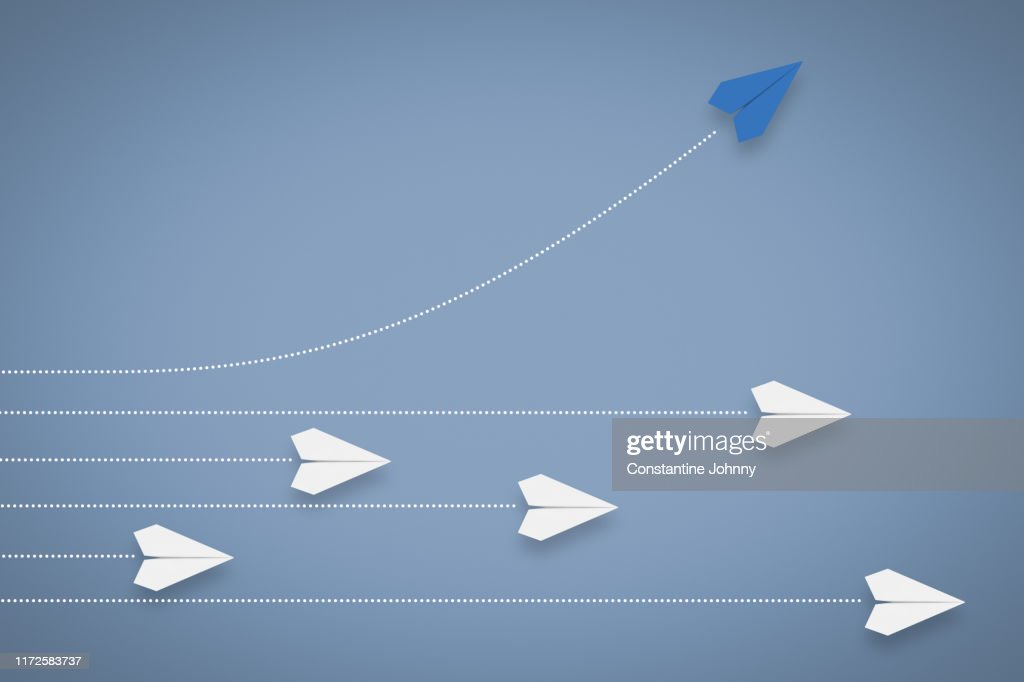 Paper Airplane Different Direction and Approach. Think Different & Leadership Concept. : Stockfoto