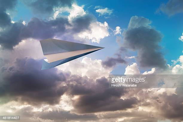 paper airplane flying in the sky - paper airplane stock pictures, royalty-free photos & images