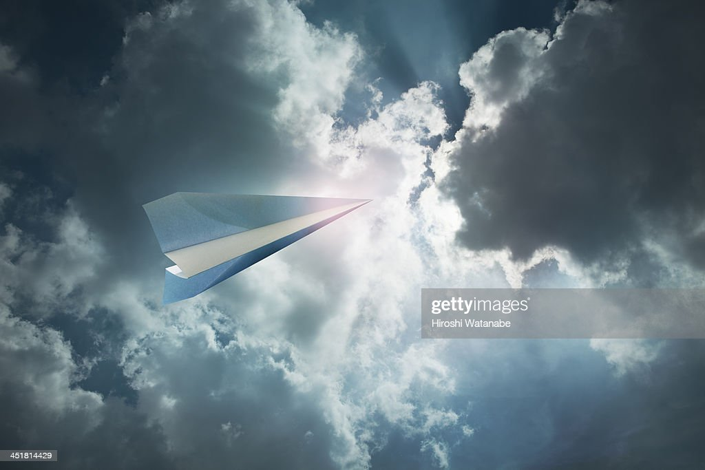 Paper airplane flying in the sky : Stock Photo