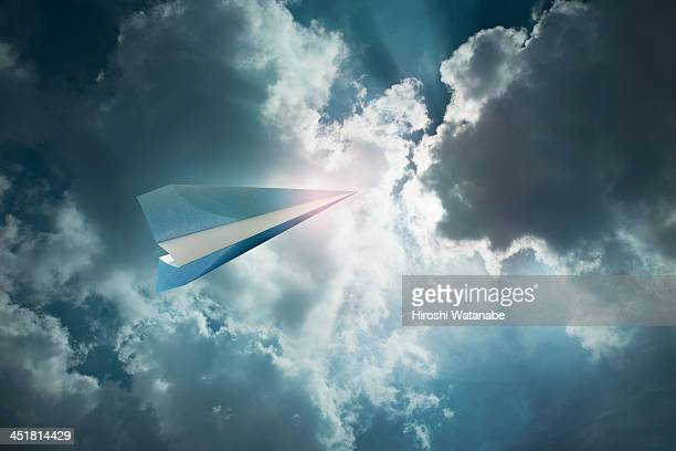 Paper airplane flying in the sky