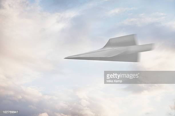paper airplane flying through the air - paper airplane stock pictures, royalty-free photos & images