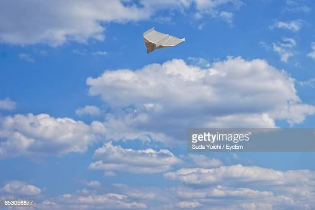Paper Airplane In Sky