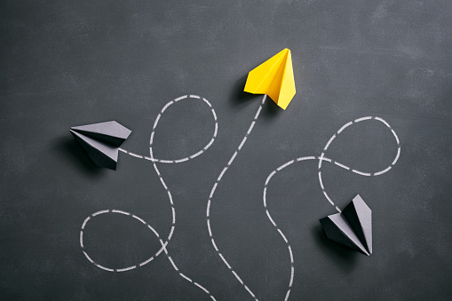 Paper airplane on blackboard - Origami Yellow Concept 959639206